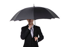 Business man asking for silence with umbrella Stock Image