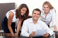 Business man with assistants Royalty Free Stock Images