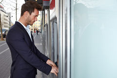 Business man on ATM getting cash Royalty Free Stock Photos