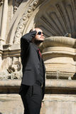 Business man awaiting for a meeting in front of a beautiful Italian scene.  royalty free stock photography