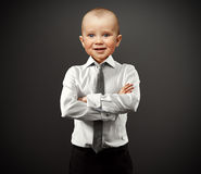 Business man with baby face Stock Images