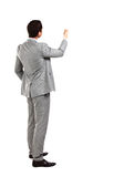 Business man from the back - looking at something. Over a white background Stock Photography