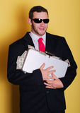 Business man bag on head hold money notes stock image