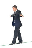 Business man balance. Business man on tightrope  concentrate to  walking isolated on white background Stock Photo
