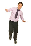Business man balance. Business man tryind to stand in one leg and holding balance isolated on white background Stock Photos