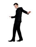 Business man balance walk Royalty Free Stock Photos