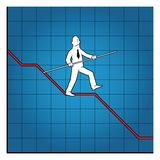 Business man balancing on declining graph Stock Photography