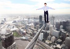 Business man balancing on the rope Royalty Free Stock Images
