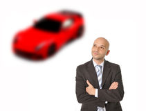 Business Man with bald head Thinking and Dreaming of Luxury Sports Ca Stock Images