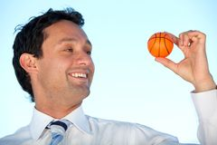 Business man with a ball Stock Images