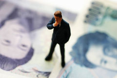 Business man on bank money Royalty Free Stock Photo
