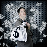 Business man in bank vault with finance money bag Stock Photos