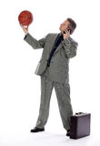 Business Man with Basket Ball and Cell Phone Royalty Free Stock Photography