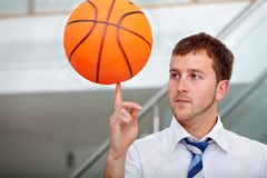 Business man with a basketball Royalty Free Stock Image