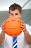 Business man with a basketball Stock Images