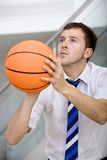 Business man with a basketball Stock Photo