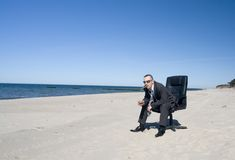 Business Man on Beach Stock Photography