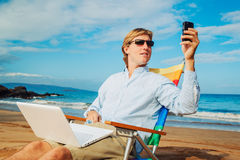 Business man on the beach Stock Images