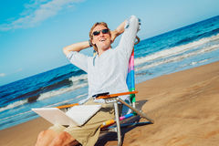 Business man on the beach Royalty Free Stock Image