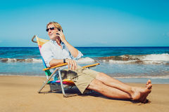 Business man on the beach Royalty Free Stock Images