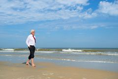 Business man at the beach royalty free stock photo