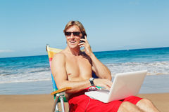 Business Man on the Beach in Hawaii Stock Images