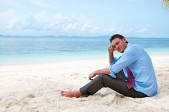 Business man on the beach Stock Image