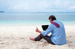Business man on the beach with tablet computer Stock Photos