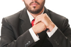 Business man with beard, black suit and red tie Royalty Free Stock Photo