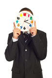 Business man behind a clock Stock Photo