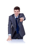 Business man behind the desk pointing Royalty Free Stock Image