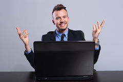 Business man behind laptop welcomes you Royalty Free Stock Photos