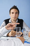 Business man behind a pointing hand Stock Photos