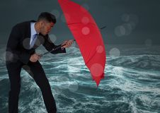 Business man behind umbrella against stormy sea with bokeh. Digital composite of Business man behind umbrella against stormy sea with bokeh stock illustration