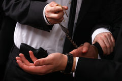 Business man being handcuffed. By a police detective, only hands visible Royalty Free Stock Photos