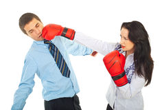 Business man being kicked. By a business woman with boxing gloves isolated on white background Stock Photography