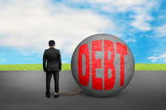 Business man being trapped with debt ball Stock Images