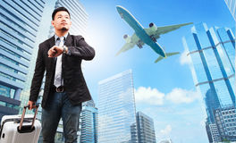 Business man and belonging luggage watching to sky and hand watc Stock Photography