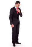 Business man bending his head down to fit his tie Royalty Free Stock Photography