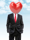 Business man with big heart instead of head. 3d illustration Stock Photo