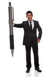 Business man with a big pen Stock Images