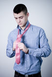 Business man binding his pink tie Royalty Free Stock Images