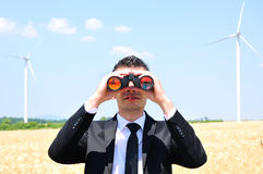 Business man with binocular Royalty Free Stock Photography