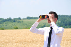 Business Man with binocular Royalty Free Stock Photo