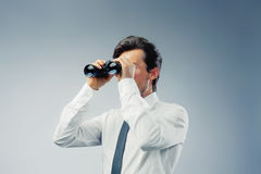 Businessman with binocular Stock Photos