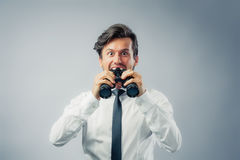 Businessman with binocular Royalty Free Stock Photo