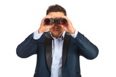 Business man with binocular Stock Images