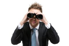 Business man with binocular. Business man wearing suit with blue tie hands binocular, isolated on white royalty free stock photos