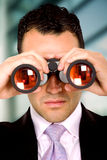 Business man with binoculars Stock Photo
