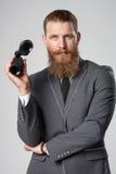 Business man with binoculars Stock Photos
